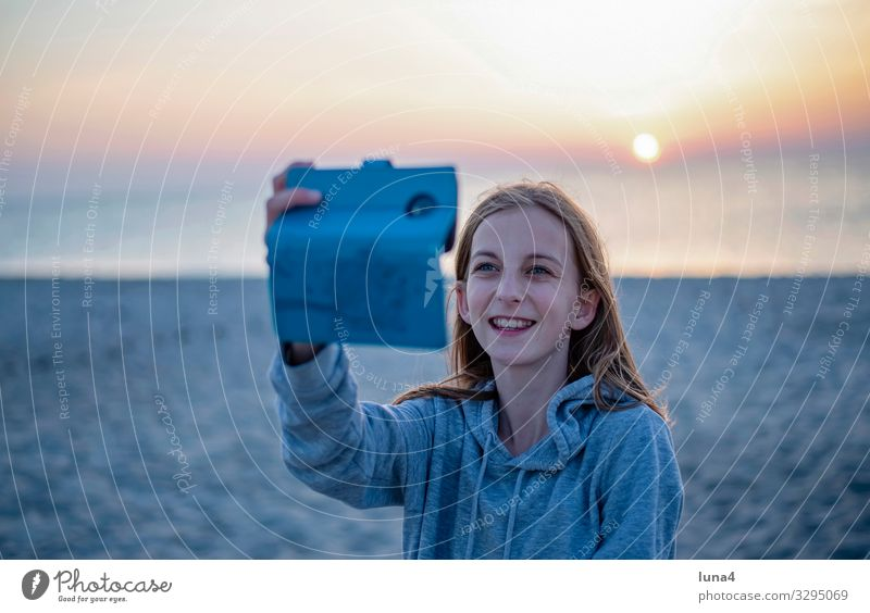 happy girl with smartphone Joy luck Contentment Ocean Child PDA Nature Baltic Sea Blonde Long-haired Laughter Happiness Positive Emotions Hope Selfie teenager