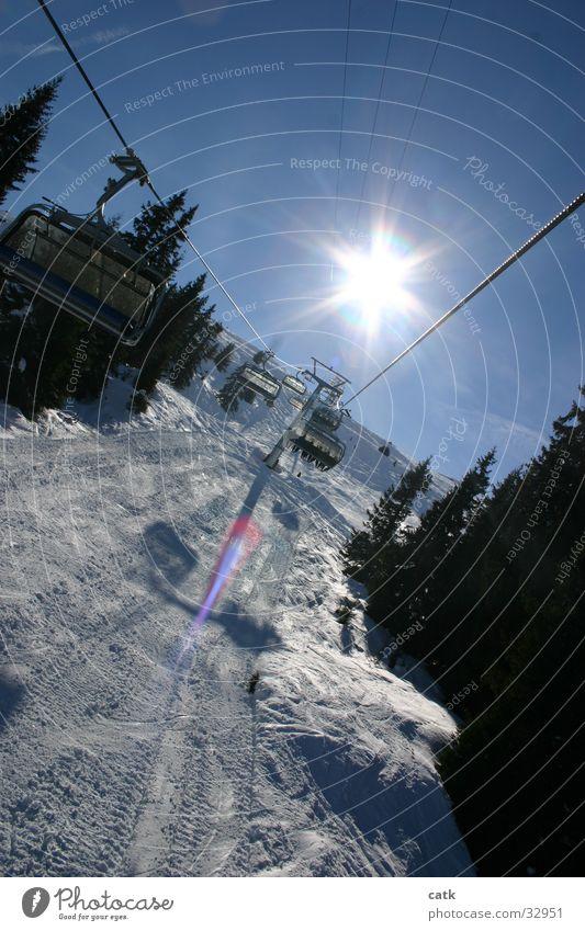 Lift in backlight Chair lift Switzerland Back-light Crap Soign Gion Laax Mountain Sun Snow