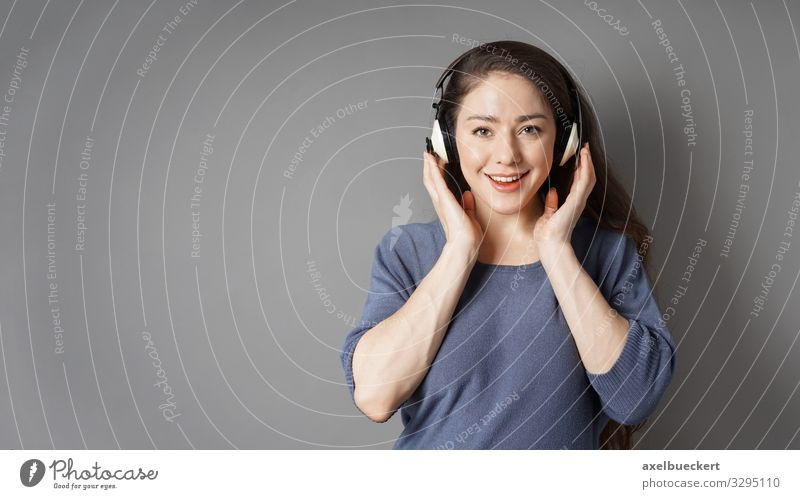 young woman with wireless headphones Music Leisure and hobbies Young woman Lifestyle Entertainment Technology Entertainment electronics Human being Feminine