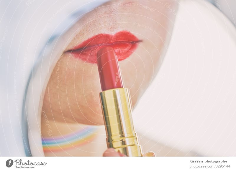 Closeup of female lips with red lipstick reflected in mirror Woman Human being Beautiful Red Eroticism Face Lifestyle Adults Feminine Style Copy Space