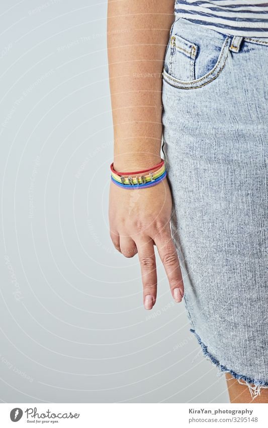 Female palm with V-sign with rainbow bracelet Lifestyle Happy Freedom Feasts & Celebrations Human being Homosexual Woman Adults Arm Hand Signage Warning sign
