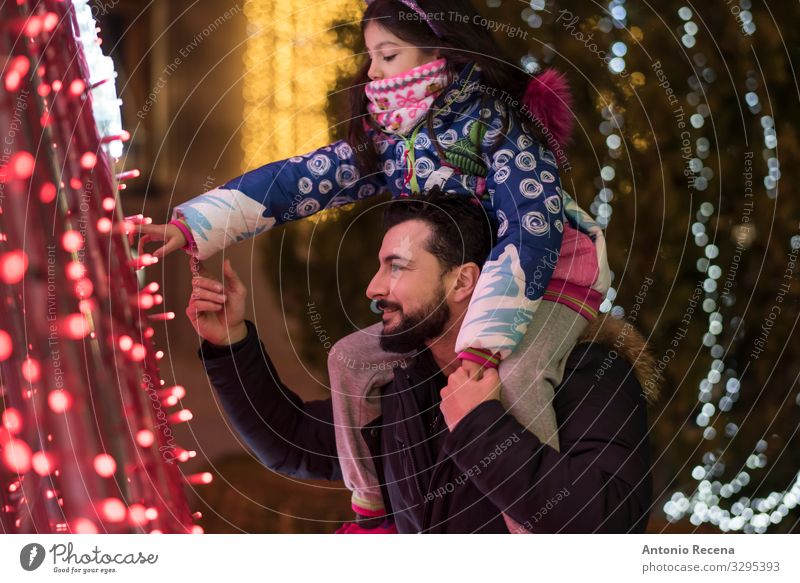 Look lights! Lifestyle Winter Decoration Child Human being Man Adults Father Family & Relations Tree Touch Carrying Together Emotions Daughter christmas City