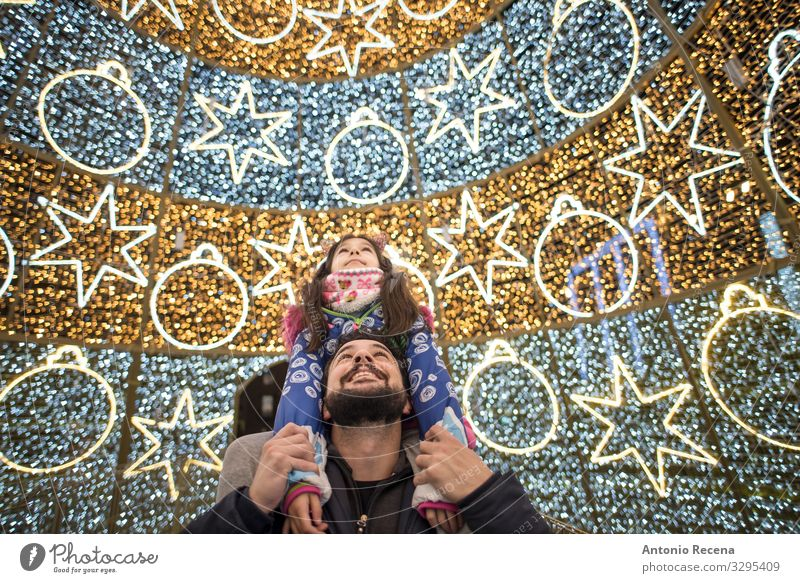 Father and daughter christmas Winter Decoration Child Human being Man Adults Family & Relations Tree Smiling Carrying Together Daughter City bearded Photography