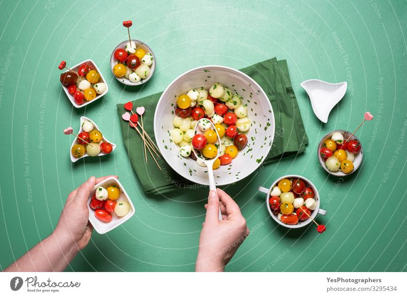 Summer salad with tomatoes and mozzarella. Caprese salad Healthy Eating Hand Delicious Vegetable Tradition Cooking Diet Refreshment Dinner Tomato Lettuce Salad