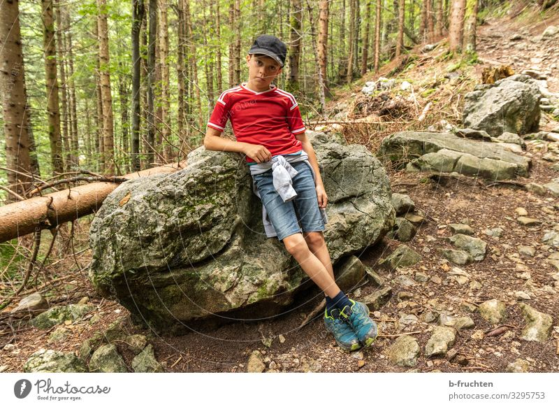 leaving the child against a stone Life Well-being Calm Leisure and hobbies Playing Vacation & Travel Trip Adventure Summer Mountain Hiking Child Boy (child) 1