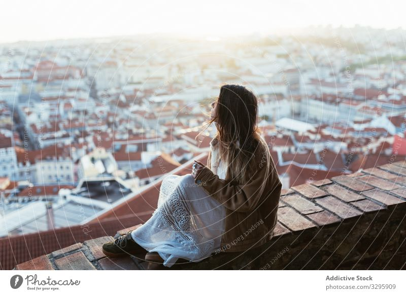 Dreamy woman sitting on border near city town morning rest sunny young dreamy admire portugal female cityscape weekend barrier brick relax lifestyle dawn