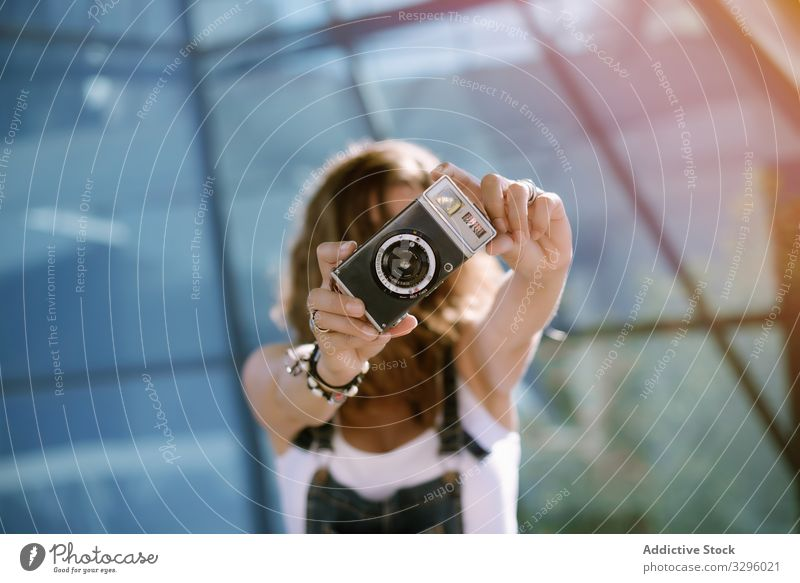 Woman taking picture with camera woman taking photo photo camera young analog photography hold portable mini photographer activity female capture film lens