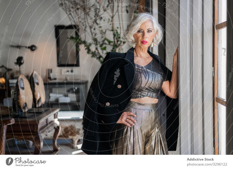 Bossy elegant woman against vintage interior in country house luxury retro stylish fashion aged appearance jacket classy well dressed charismatic bossy senior