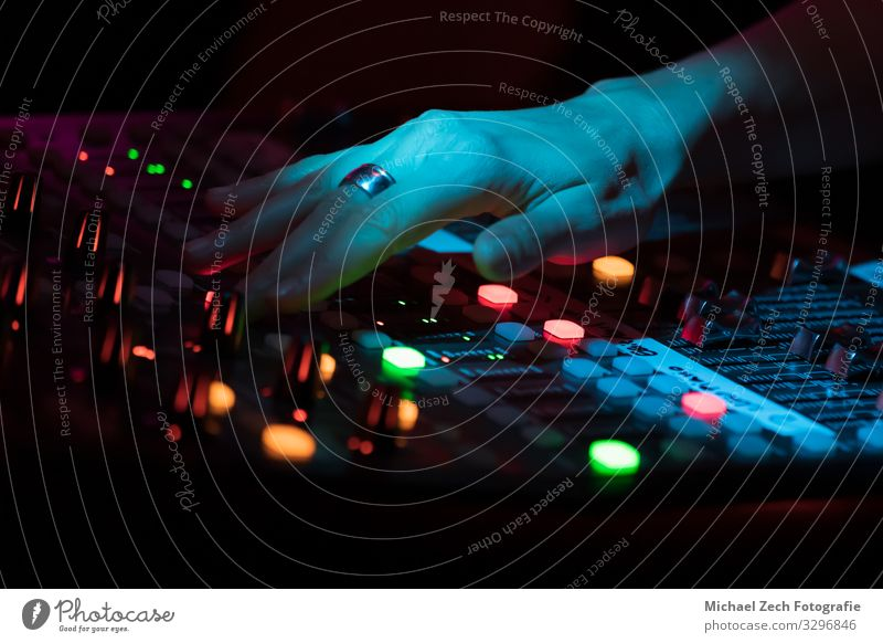 Hand on a professional concert sound mixer Line Music Technology Media Balance Digital Concert Testing & Control Channel Buttons Entertainment Musician Sound