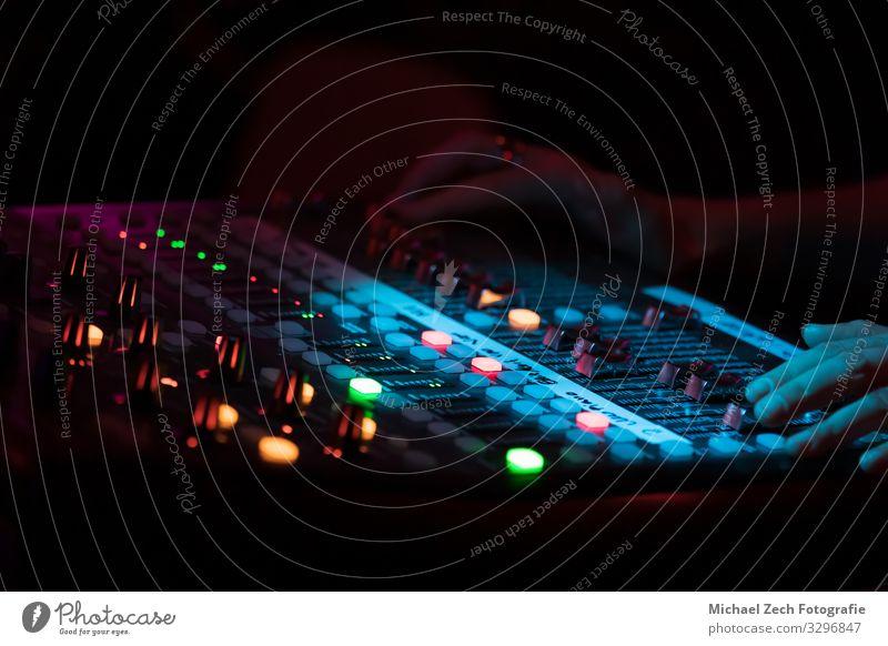 Hands on a professional concert sound mixer Line Music Technology Media Balance Digital Concert Testing & Control Channel Buttons Entertainment Musician Sound