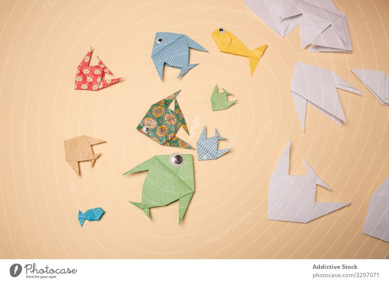 Paper origami fish paper concept craft creative hobby inspiration handmade pastime handicraft art fold colorful multicolored skill design detail shape animal