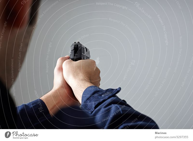 Police officer's hands aiming with gun. Human being Man Adults White Safety Safety (feeling of) police Handgun policeman Police Officer defense crime Aim