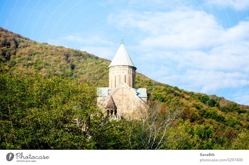 old antique christian church with a dome and a cross Vacation & Travel Tourism Mountain Nature Landscape Plant Sky Clouds Autumn Tree Forest Hill Church
