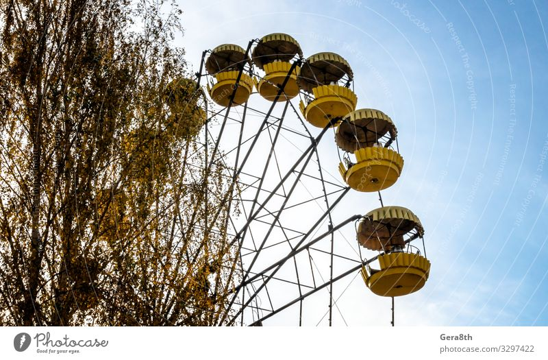 old carousel wheel in an abandoned amusement park in Chernobyl Vacation & Travel Tourism Trip Nature Landscape Sky Autumn Tree Leaf Park Rust Old Threat Blue