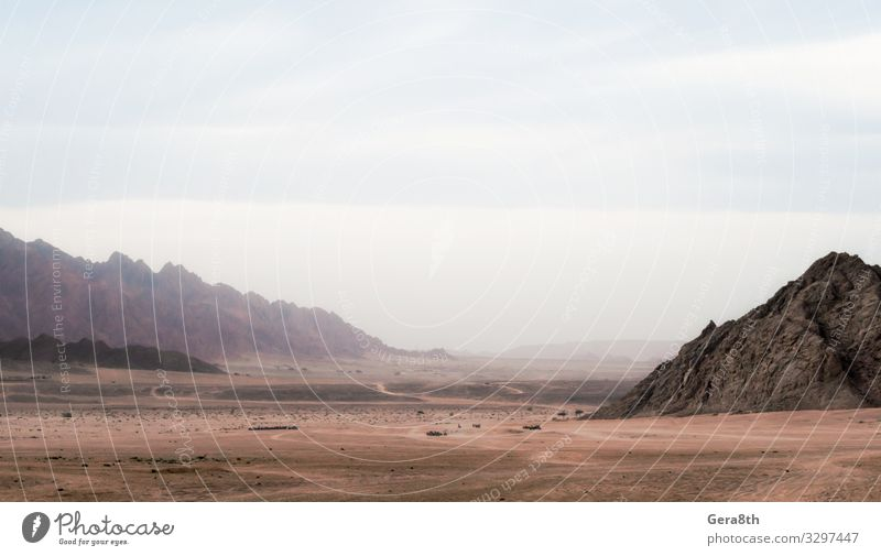 panoramic view of desert with rocky mountains in Egypt Exotic Vacation & Travel Tourism Trip Mountain Nature Landscape Sky Clouds Fog Rock Stone Dark Colour