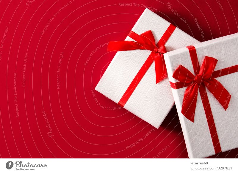 Assorted white gift boxes on red background. Top view Gift Christmas & Advent Box bow String Red Birthday Vacation & Travel Feasts & Celebrations Public Holiday