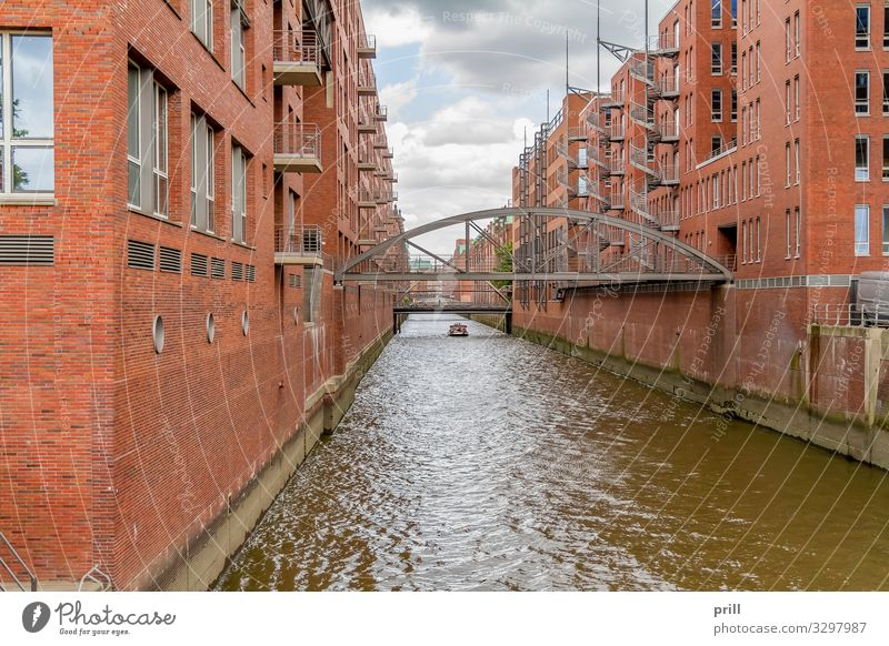 Speicherstadt in Hamburg Culture Water Coast Bridge Manmade structures Building Architecture Wall (barrier) Wall (building) Facade Watercraft Brick Old Historic