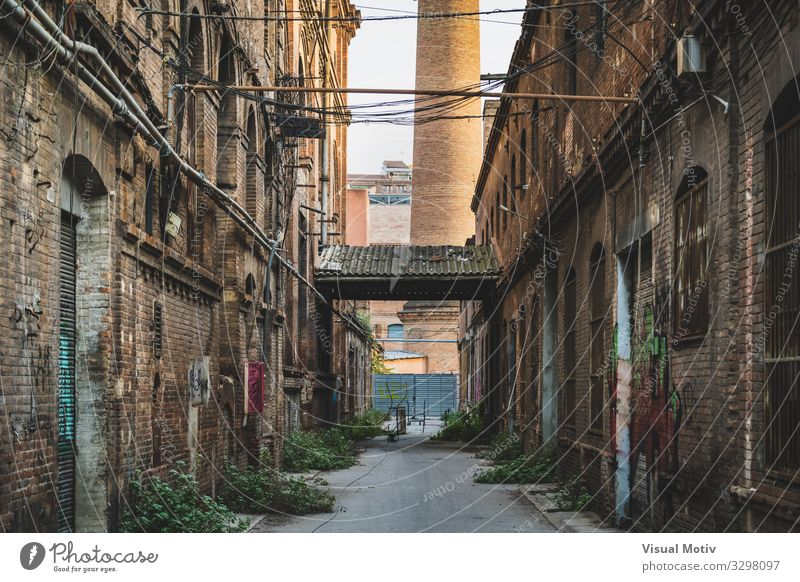 Alley of an old factory II Town Window Street Architecture Wood Wall (building) Lanes & trails Building Wall (barrier) Stone Brown Facade Metal Retro Door Glass