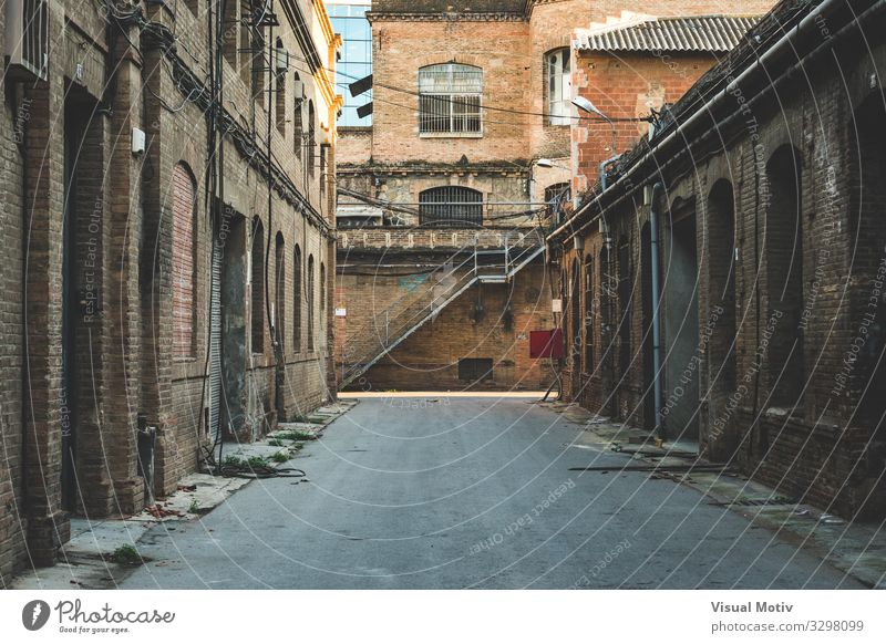 Frontal perspective of the alley of an old textile factory Capital city Industrial plant Factory Manmade structures Building Architecture Lanes & trails Alley