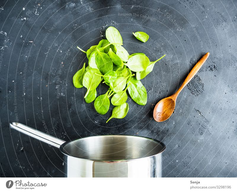 Cooking pot with fresh leaf spinach and cooking spoon Food Vegetable Spinach Nutrition Lunch Dinner Organic produce Vegetarian diet Diet Pot Spoon Lifestyle