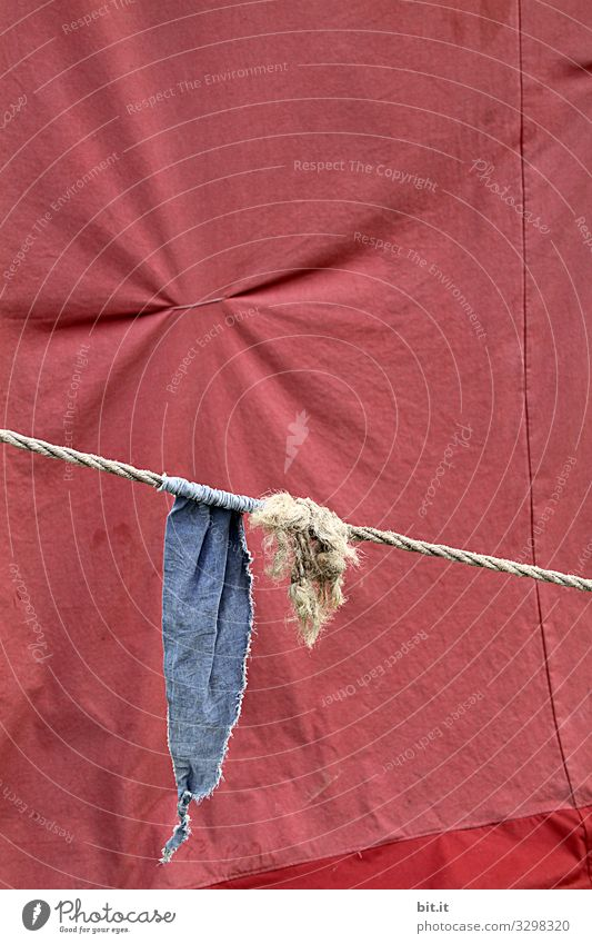 Blue flag, pennant, flag hangs on the rope, cord with knots, in front of tent tarpaulin in red, with pulled together fabric, to fold, at an event. Tent Knot