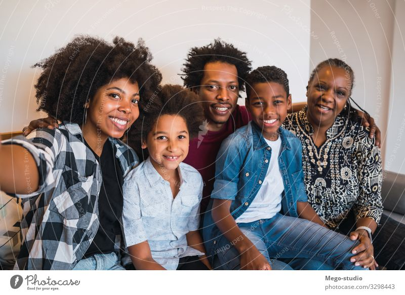 Portrait of african american multigenerational family taking a selfie together at home. Family and lifestyle concept. Lifestyle Joy Happy
