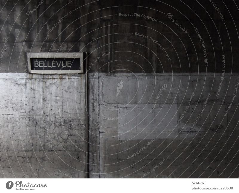bellevue Architecture Wall (barrier) Wall (building) Underground Concrete Characters Signs and labeling Signage Warning sign Dirty Dark Brown Gray Esthetic