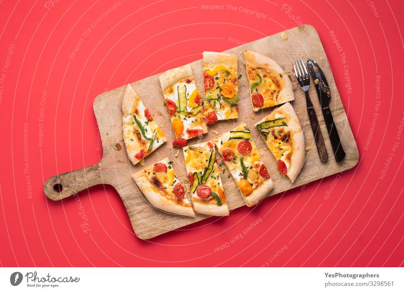 Sliced pizza primavera on wooden board. Spring pizza Vegetable Dinner Italian Food Cutlery Healthy Eating Fresh Delicious Tradition Mediterranean food