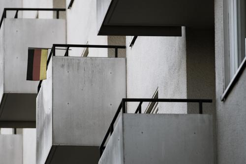 Urban Tristesse Town House (Residential Structure) High-rise Manmade structures Facade Balcony Flag Poverty Threat Dark Cold Modern Cliche Gloomy Disappointment