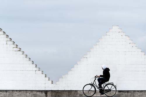 City pyramid and cyclists Cycling Bicycle Human being 1 Town Manmade structures Wall (barrier) Wall (building) Stairs Means of transport Traffic infrastructure