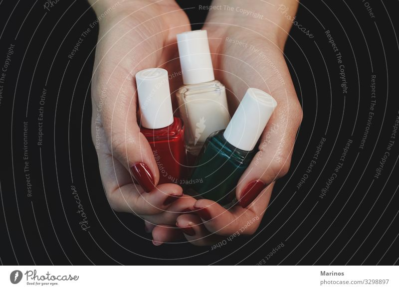 Polish bottles in woman hands. Bottle Beautiful Manicure Medical treatment Spa Human being Woman Adults Hand Fingers Red Colour nail care salon trimming