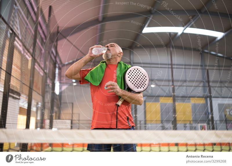 Water time Drinking Playing Sports Human being Man Adults Bald or shaved head Beard Old senior paddle tennis training padel sportsman Mature 50s 60s Action