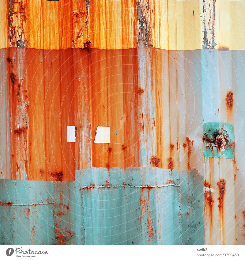 in progress Container Tin Corrugated sheet iron Metal Rust Blue Multicoloured Yellow Orange Turquoise Transience Change Destruction Dye Smear Tracks
