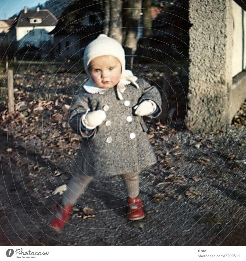 dancing queen Feminine girl 1 Human being Beautiful weather Autumn leaves House (Residential Structure) Wall (barrier) Wall (building) Coat Gloves Footwear cap