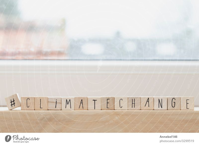 Wooden cubes with a Hashtag and the word Climate Change, Design Business Environment Nature Earth Climate change Globe Hot Blue Green White Conceptual design