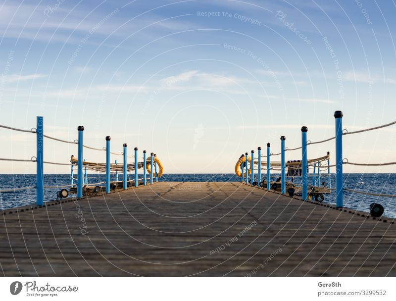 wooden platform with blue posts with ropes in Egypt Dahab Exotic Vacation & Travel Summer Ocean Nature Landscape Sky Clouds Horizon Warmth Wood Blue Red Sea