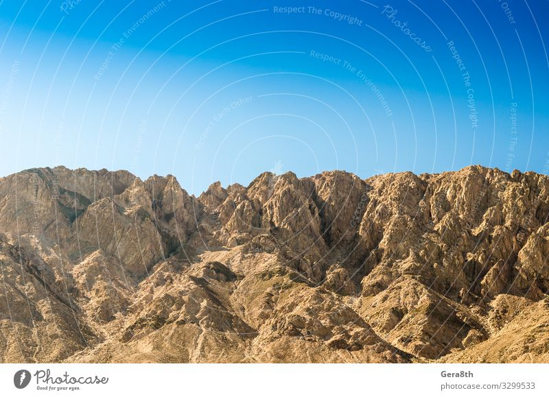 high rocky mountains against a clear blue sky Sky Vacation & Travel Nature Summer Blue Landscape Mountain Yellow Natural Stone Rock Height Egypt Geology
