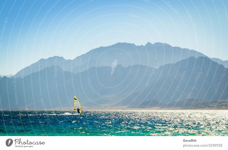 surfer rides into the sea in Egypt Dahab Vacation & Travel Nature Blue Colour Landscape Ocean Relaxation Mountain Sports Coast Tourism Rock Bright Waves