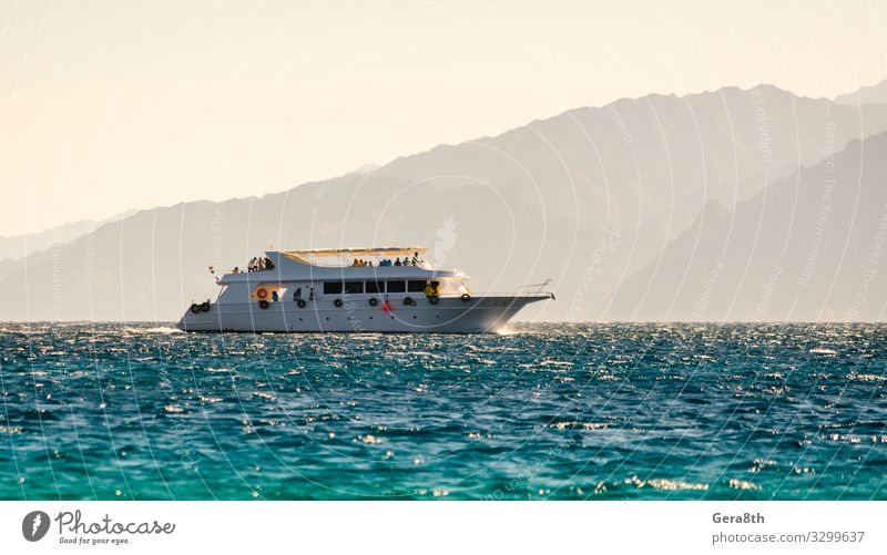 big boat on the background of high mountains in Egypt Dahab Relaxation Vacation & Travel Tourism Cruise Summer Ocean Waves Mountain Nature Landscape Warmth