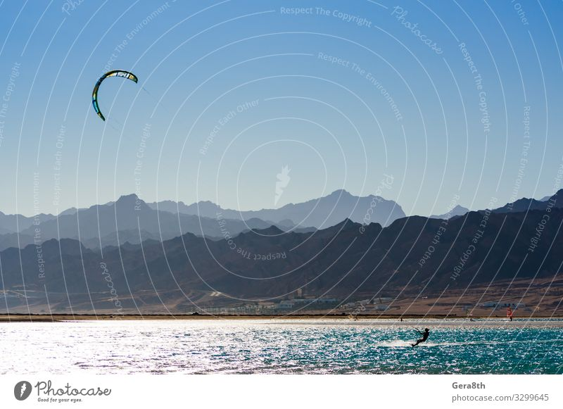 kitesurfer rides in the Red Sea in Egypt Dahab Exotic Vacation & Travel Tourism Summer Ocean Waves Mountain Sports Aquatics Nature Landscape Sky Horizon Wind