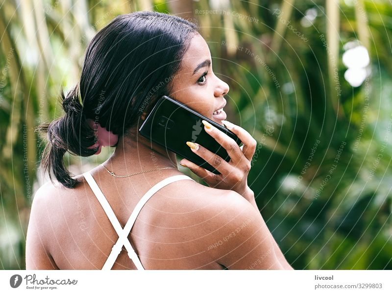 pretty woman talking with her phone II , cuba Woman Human being Nature Youth (Young adults) Young woman Plant Blue Beautiful Green Hand Black 18 - 30 years Face