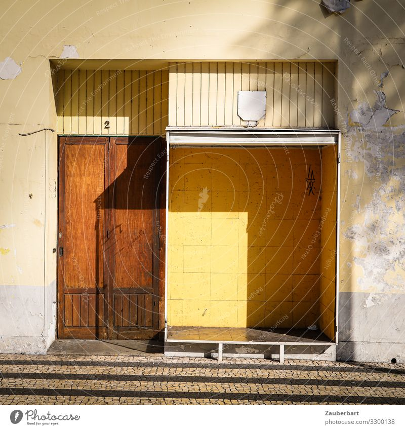 Empty shop / structures brown - yellow - shadow Store premises Shop window Trade Insolvency Funchal Madeira Deserted Stone Wood Glass Stand Sharp-edged Gloomy