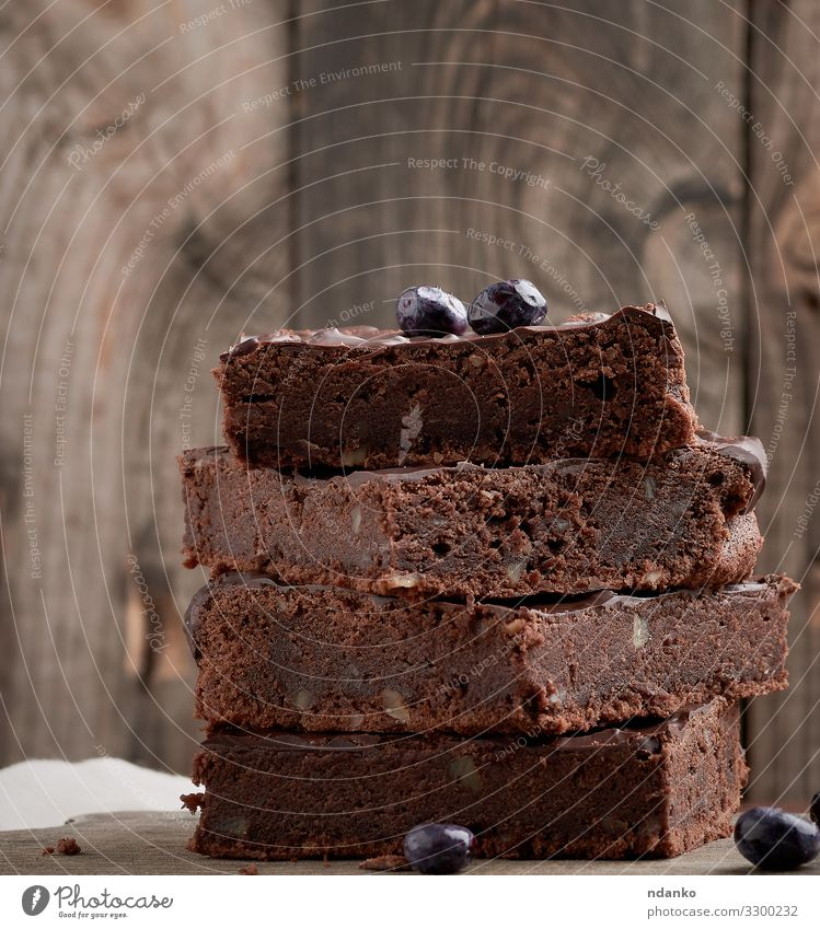 brownie chocolate cake with walnuts Cake Dessert Candy Chocolate Nutrition Eating Hot Chocolate Table Wood Dark Fresh Delicious Brown Black Tradition Stack Pie