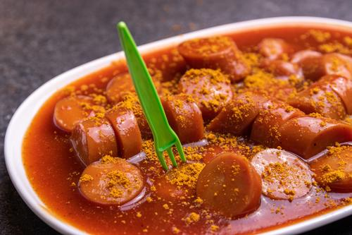 currywurst Food Sausage Nutrition Fast food Crockery Plate Fork Healthy Eating Unhealthy Hotdog Spicy Part Sauce Germany Dish Colour photo Interior shot
