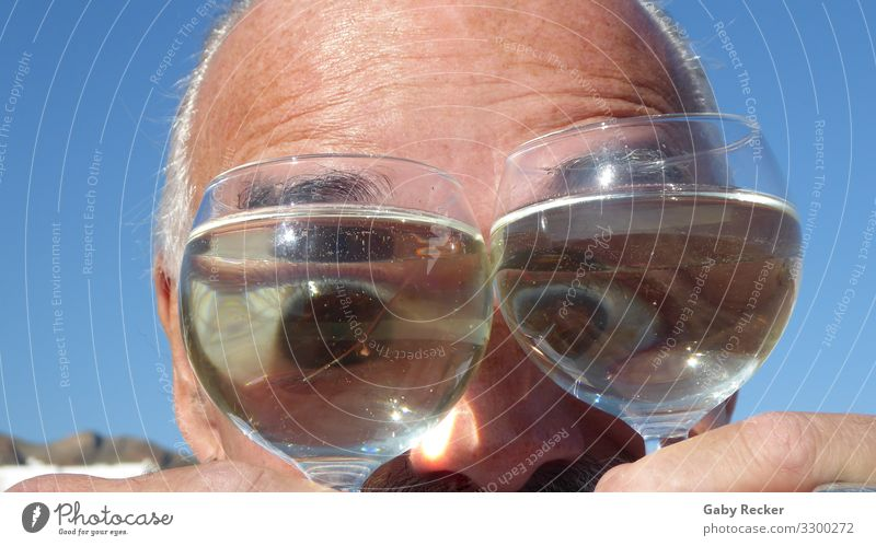 Eyes through the wine glass Human being Masculine Man Adults Life Head 1 45 - 60 years Moody Joy Happiness Cool (slang) Funny Colour photo Exterior shot
