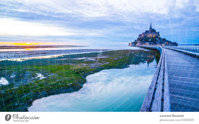 Mont-Saint-Michel from the bridge Vacation & Travel Tourism Ocean Island Landscape Architecture Monument Blue France Monastery bay bretagne Brittany Europe