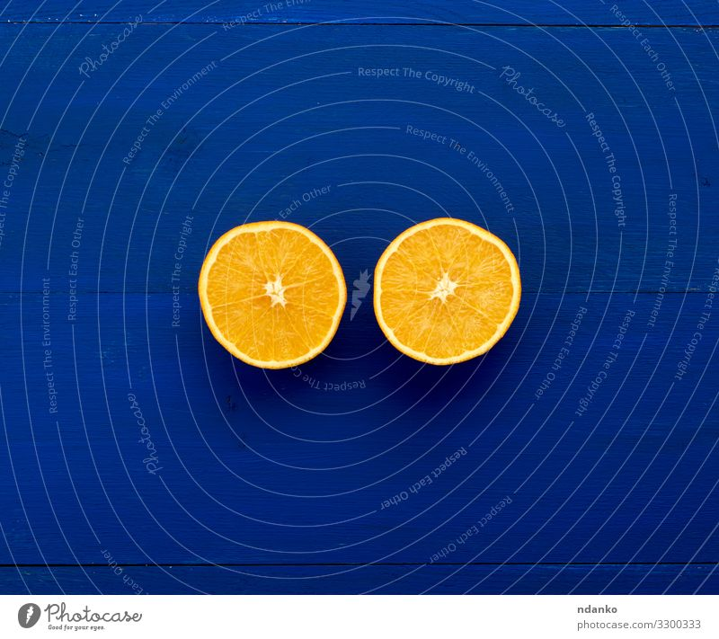 two halves of an orange round orange Fruit Dessert Nutrition Vegetarian diet Diet Juice Nature Wood Fresh Small Natural Juicy Blue Colour Half background citrus