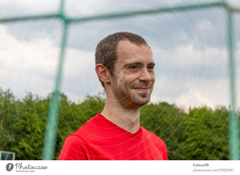 Portrait of a young sportsman Lifestyle Leisure and hobbies Sports Football pitch Human being Man Adults 1 30 - 45 years Movement portrait youthful Smiling