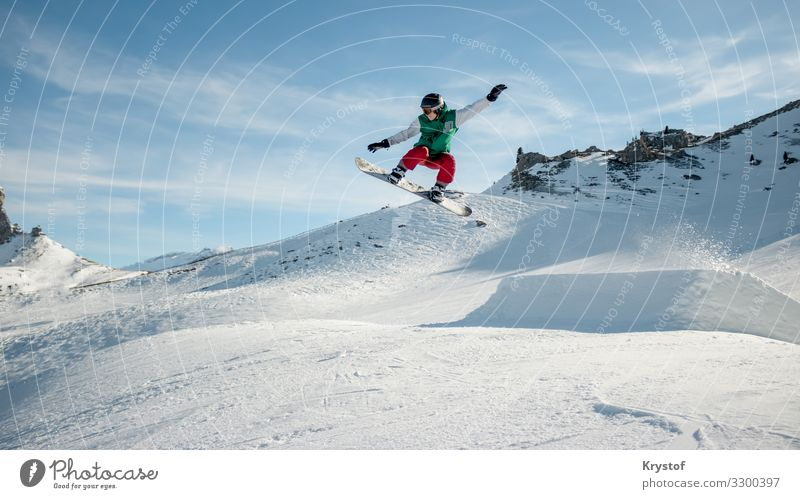 Jumping snowboarder Sports Snowboard Nature Ice Frost Moody Alps Austria Winter Colour photo Exterior shot Day Wide angle Forward