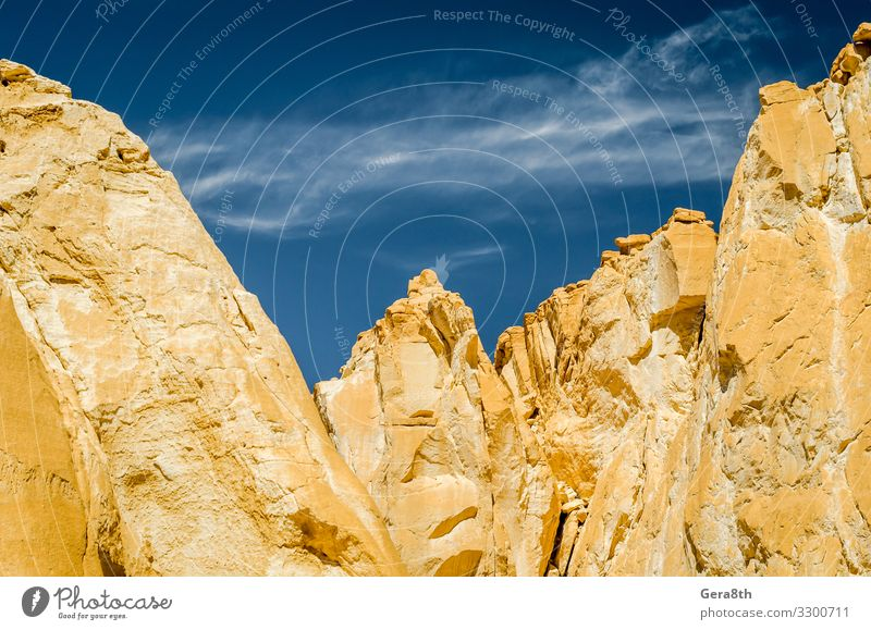 high rocky mountains in Egypt Vacation & Travel Tourism Summer Mountain Nature Landscape Sand Sky Clouds Warmth Hill Rock Canyon Stone Blue White Dahab